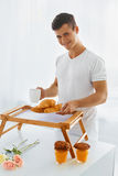 Portrait of man in the morning. Romantic breakfast Royalty Free Stock Photo