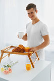 Portrait of man in the morning. Romantic breakfast Royalty Free Stock Image