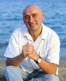 Portrait of   man near  sea. Stock Photos