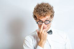 Portrait of a man with nerd glasses n studio fun Royalty Free Stock Image