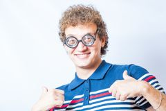 Portrait of a man with nerd glasses n studio fun Royalty Free Stock Images