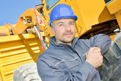 Portrait man next to heavy plant machinery Royalty Free Stock Image