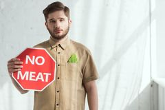 Portrait of man with no meat sign and savoy cabbage leaf in pocket vegan. Lifestyle concept royalty free stock photos