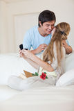 Portrait of a man offering a jewel to his girlfriend Stock Images
