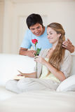 Portrait of a man offering a rose to his fiance Royalty Free Stock Images