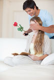 Portrait of a man offering a rose to his girlfriend Royalty Free Stock Photo