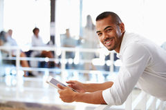 Portrait of man in office using tablet Royalty Free Stock Image
