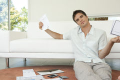 Portrait of Man with Paperwork Sitting on Floor Stock Image