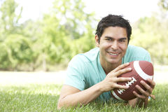 Portrait Of Man In Park With American Footba Stock Photo