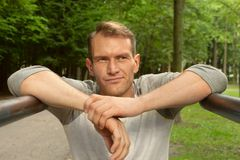Portrait of man. In a park. Bars and training Royalty Free Stock Images