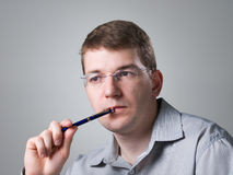 Portrait of man with pen Royalty Free Stock Photos
