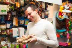 Portrait of man with pet supplements Stock Photo