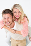 Portrait of a man piggybacking woman Royalty Free Stock Photography