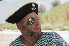 Portrait of a man in a pirate costume on the beach Stock Images