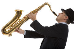 Saxophonist. Portrait of a man playing on saxophone isolated on background Stock Photo