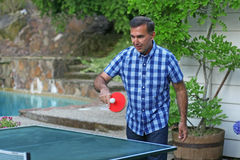Portrait of a man playing table tennis Stock Images