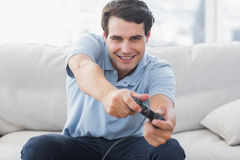 Portrait of a man playing video games Royalty Free Stock Images