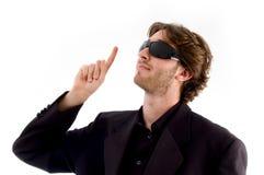 Portrait of man pointing upward Royalty Free Stock Image