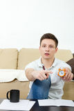 Portrait of man pointing at watch running out of time Stock Images