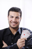 Portrait of man with poker cards. Man with ace poker; four aces in hands; smiling and looking in camera Stock Photography