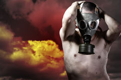 Portrait of a man in a polluted ambience with gas mask Stock Photos