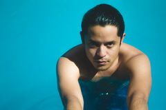 Portrait of a man in the pool. For summer time royalty free stock image