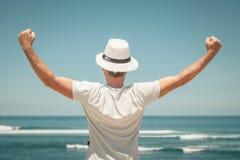 Portrait of  man posing outdoor in summer sun light wearing  hat Stock Photo