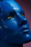 Portrait of a man poured blue paint  Royalty Free Stock Photo