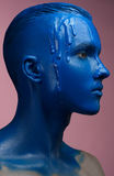 Portrait of a man poured blue paint Stock Photography