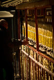 Portrait of a man with prayer wheels in The Palkhor Monastery Gy Stock Images