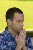Portrait of man praying Stock Photos