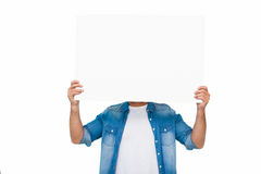 Portrait of a man presenting a panel Stock Images