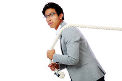 Portrait of a man pulling rope Stock Photos