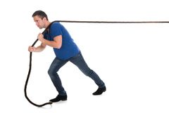 Portrait of a man pulling rope Royalty Free Stock Photos