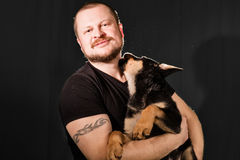 Portrait of a man with puppy dog Royalty Free Stock Photography