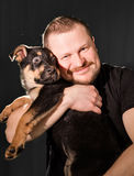 Portrait of a man with puppy dog Royalty Free Stock Images