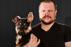 Portrait of a man with puppy dog Stock Image