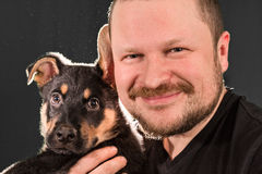 Portrait of a man with puppy dog Royalty Free Stock Photo