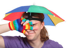 Portrait of man with rainbow hat umbrella Royalty Free Stock Images