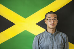 Portrait of a man with raised eyebrows against Jamaican flag Royalty Free Stock Photos