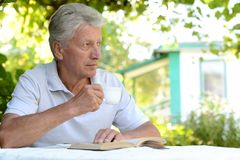 Portrait of a man reading Stock Photos