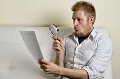 Portrait of a man reading a contract Stock Photo