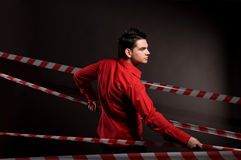 Portrait of man in red shirt on black Royalty Free Stock Images