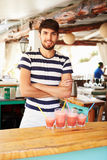 Portrait Of Man In Restaurant Making Fruit Smoothies Royalty Free Stock Photo