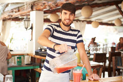 Portrait Of Man In Restaurant Making Fruit Smoothies Royalty Free Stock Photos