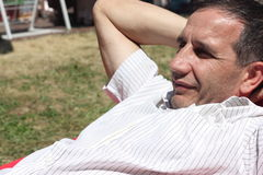 Portrait of a man. Resting on the lawn Stock Photos