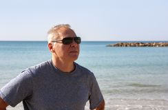 Portrait of a man of retirement age on the background of the sea royalty free stock image