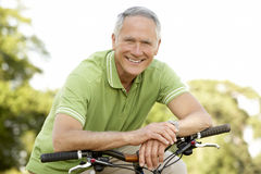 Portrait of man riding cycle in countryside Royalty Free Stock Photo