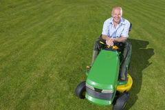 Portrait of man on riding lawn mower Stock Image