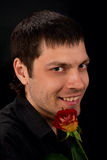 Portrait of a man with rose. Royalty Free Stock Photo